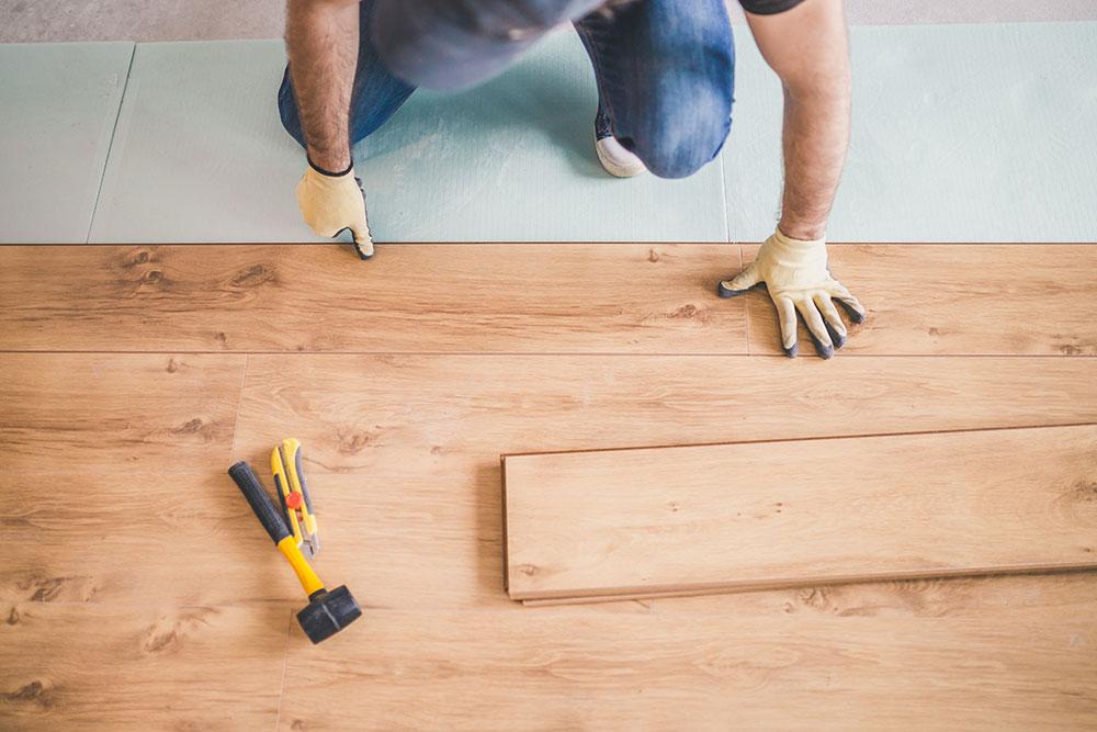 hybrid flooring being laid